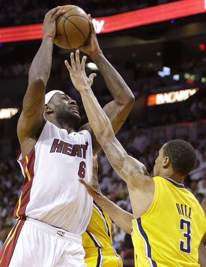 Miami Heat small forward LeBron James (6) works against Indiana Pacers point guard George Hill (3) during the second half of Game 7 in their NBA basketball Eastern Conference finals playoff series, Monday, June 3, 2013 in Miami. (AP Photo/Lynne Sladky)