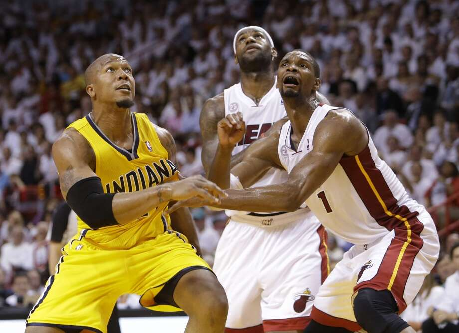 Indiana Pacers forward David West (21), Miami Heat center Chris Bosh (1) and forward LeBron James (6) wait for the rebound during the first half of Game 7 in their NBA basketball Eastern Conference finals playoff series, Monday, June 3, 2013 in Miami. (AP Photo/Lynne Sladky)