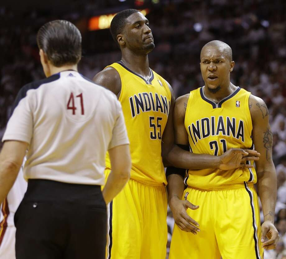 Official Ken Mauer (41) calls a foul against Indiana Pacers power forward David West (21) as Indiana Pacers center Roy Hibbert (55) looks on during the second half of Game 7 in their NBA basketball Eastern Conference finals playoff series against the Miami Heat, Monday, June 3, 2013 in Miami. (AP Photo/Lynne Sladky)