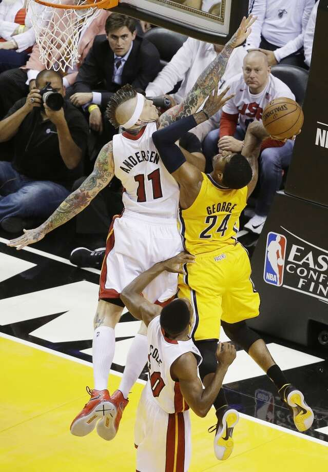 Indiana Pacers small forward Paul George (24) heads to the hoop as Miami Heat power forward Chris Andersen (11) defends during the first half of Game 7 in their NBA basketball Eastern Conference finals playoff series, Monday, June 3, 2013 in Miami. (AP Photo/Wilfredo Lee)
