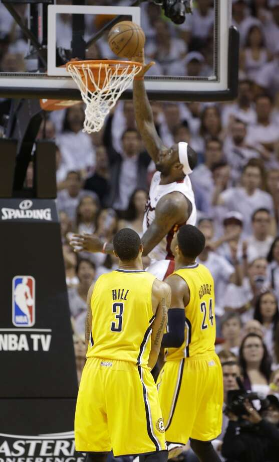 Miami Heat forward LeBron James (6) dunks the ball over Indiana Pacers guards George Hill (3) and Paul George (24)during the first half of Game 7 in their NBA basketball Eastern Conference finals playoff series, Monday, June 3, 2013 in Miami. (AP Photo/Lynne Sladky)