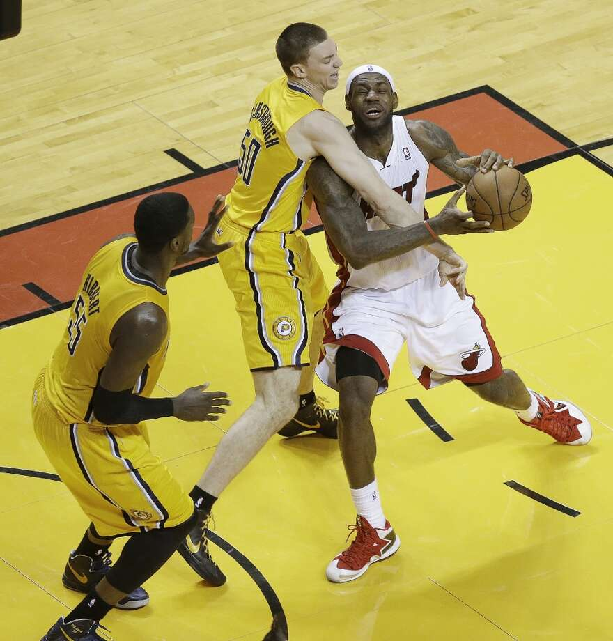 Miami Heat small forward LeBron James (6) works against Indiana Pacers power forward Tyler Hansbrough (50) and Indiana Pacers center Roy Hibbert (55) during the first half of Game 7 in their NBA basketball Eastern Conference finals playoff series, Monday, June 3, 2013 in Miami. (AP Photo/Wilfredo Lee)
