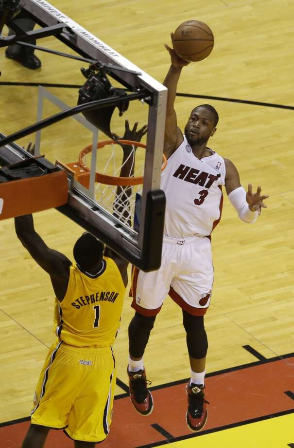 Miami Heat guard Dwyane Wade (3) drives to the basket over Indiana Pacers guard Lance Stephenson (1) during the first half of Game 7 in their NBA basketball Eastern Conference finals playoff series, Monday, June 3, 2013 in Miami. (AP Photo/Wilfredo Lee)