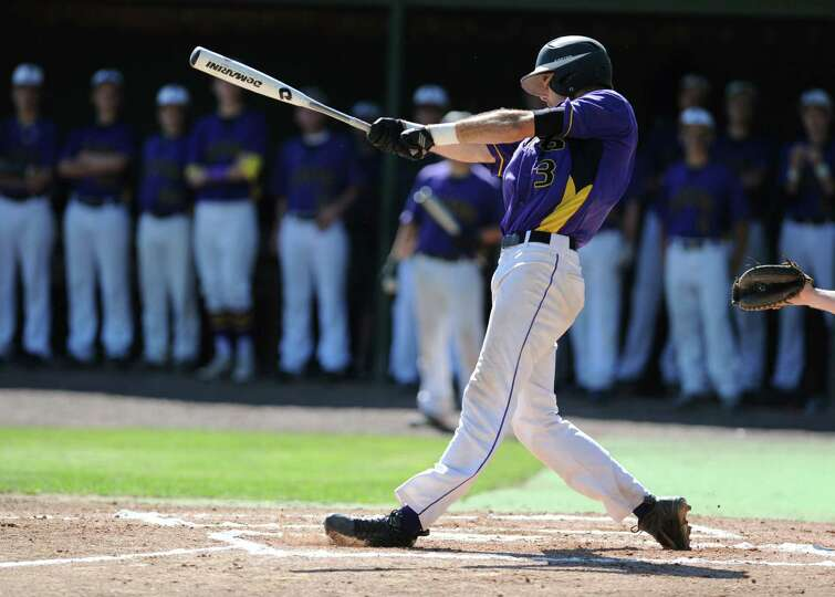 Voorheesville's Nico Church hits a single during the Class C state regional baseball game against No