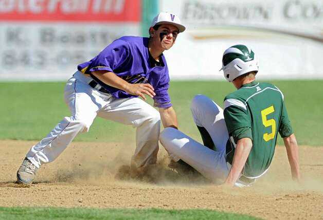 Voorheesville's Tom Gallager puts the tag on a Norwood-Norfolk runner but doesn't get him out during the Class C state regional semi-final baseball game on Monday, June 3, 2013 in Amsterdam, N.Y.  (Lori Van Buren / Times Union) Photo: Lori Van Buren / 00022669A