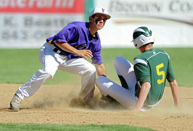 Voorheesville's Tom Gallager puts the tag on a Norwood-Norfolk runner but doesn't get him out during
