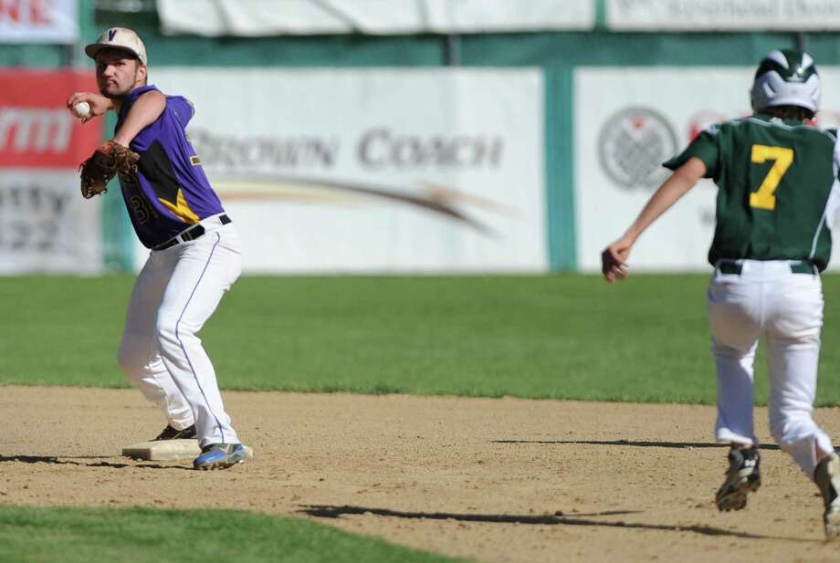 Voorheesville's Mike Young tries to turn a double play but doesn't get the runner at first during the Class C state regional semi-final baseball game against Norwood-Norfolk on Monday, June 3, 2013 in Amsterdam, N.Y.  (Lori Van Buren / Times Union) Photo: Lori Van Buren / 00022669A