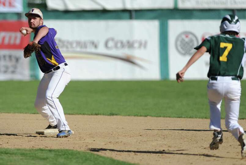 Voorheesville's Mike Young tries to turn a double play but doesn't get the runner at first during th