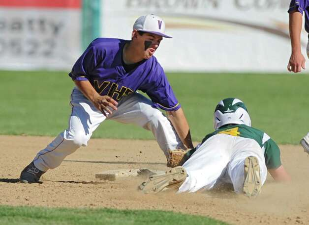 Voorheesville's Tom Gallager puts the tag on a Norwood-Norfolk runner but drops the ball in the play during the Class C state regional semi-final baseball game on Monday, June 3, 2013 in Amsterdam, N.Y.  (Lori Van Buren / Times Union) Photo: Lori Van Buren / 00022669A