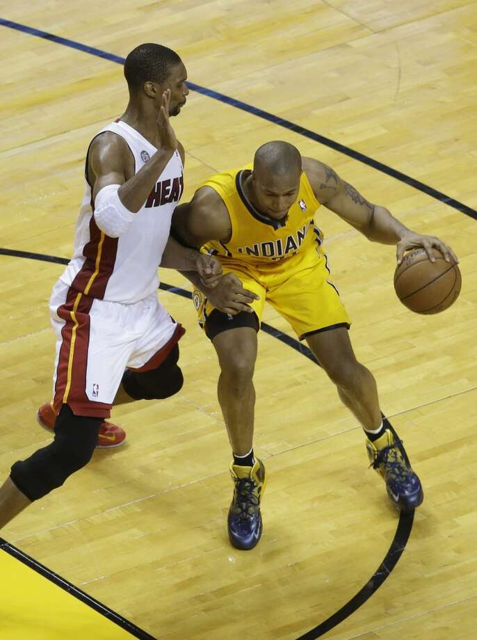 Miami Heat center Chris Bosh (1) defends Indiana Pacers power forward David West (21) during the second half of Game 7 in their NBA basketball Eastern Conference finals playoff series, Monday, June 3, 2013 in Miami. (AP Photo/Wilfredo Lee)