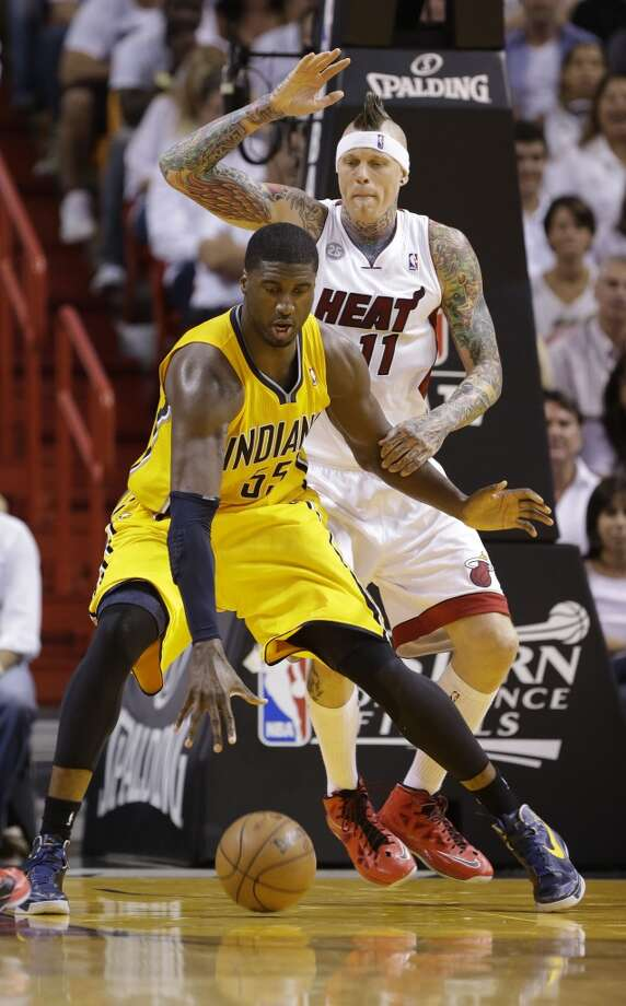 Indiana Pacers center Roy Hibbert (55) dribbles the ball as Miami Heat power forward Chris Andersen (11) defends during the second half of Game 7 in their NBA basketball Eastern Conference finals playoff series, Monday, June 3, 2013 in Miami. (AP Photo/Lynne Sladky)
