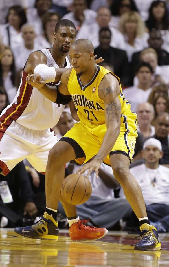 Indiana Pacers forward David West (21) dribbles the ball as Miami Heat center Chris Bosh (1) during the second half of Game 7 in their NBA basketball Eastern Conference finals playoff series, Monday, June 3, 2013 in Miami. (AP Photo/Lynne Sladky)