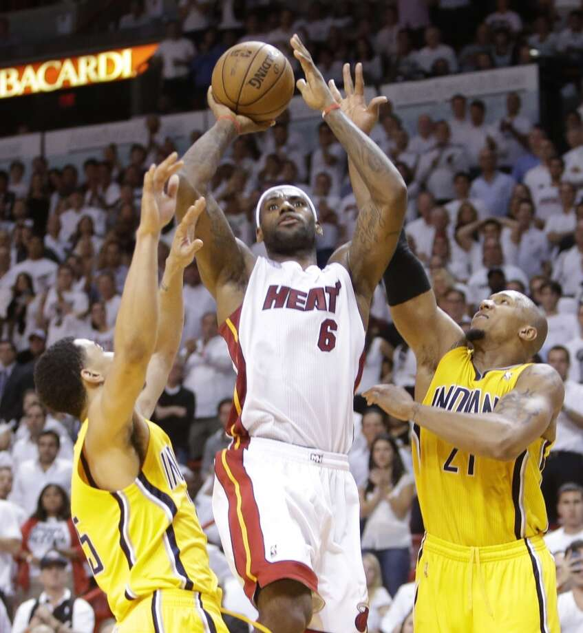 Miami Heat small forward LeBron James (6) works against Indiana Pacers power forward David West (21) and Indiana Pacers center Roy Hibbert (55) during the second half of Game 7 in their NBA basketball Eastern Conference finals playoff series, Monday, June 3, 2013 in Miami. (AP Photo/Lynne Sladky)