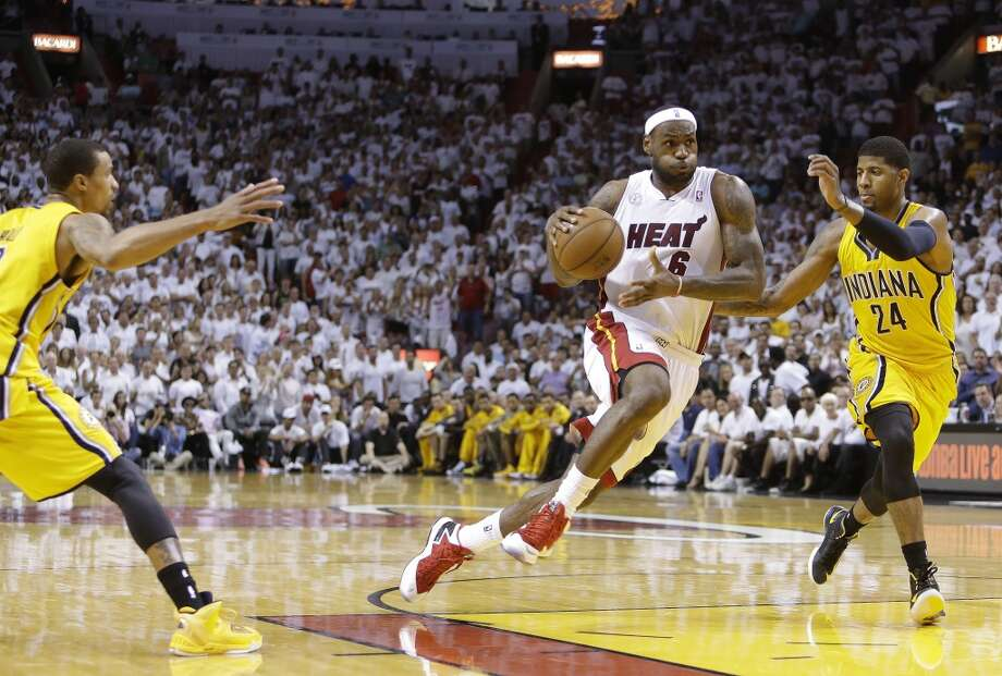 Miami Heat small forward LeBron James (6) drives past Indiana Pacers small forward Paul George (24) during the second half of Game 7 in their NBA basketball Eastern Conference finals playoff series, Monday, June 3, 2013 in Miami. (AP Photo/Lynne Sladky)