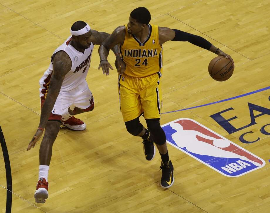 Indiana Pacers  forward Paul George (24) looks to pass as Miami Heat  forward LeBron James (6) defends during the second half of Game 7 in their NBA basketball Eastern Conference finals playoff series, Monday, June 3, 2013 in Miami. (AP Photo/Wilfredo Lee)