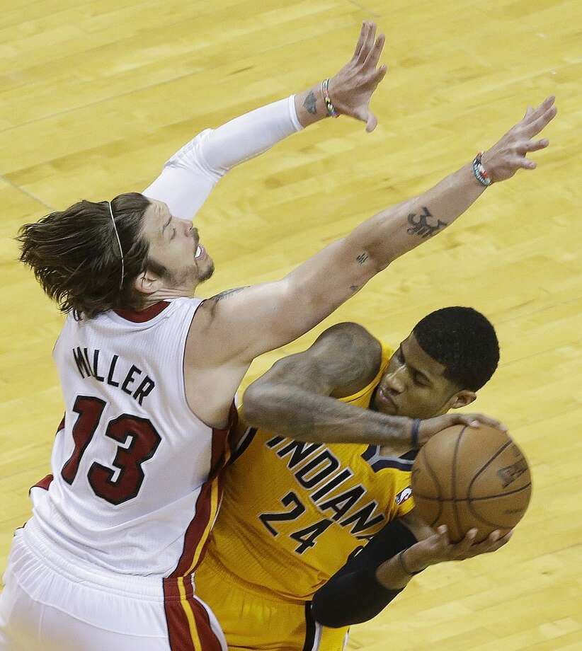 Miami Heat shooting guard Mike Miller (13) defends against Indiana Pacers small forward Paul George (24) during the second half of Game 7 in their NBA basketball Eastern Conference finals playoff series, Monday, June 3, 2013 in Miami. (AP Photo/Wilfredo Lee)