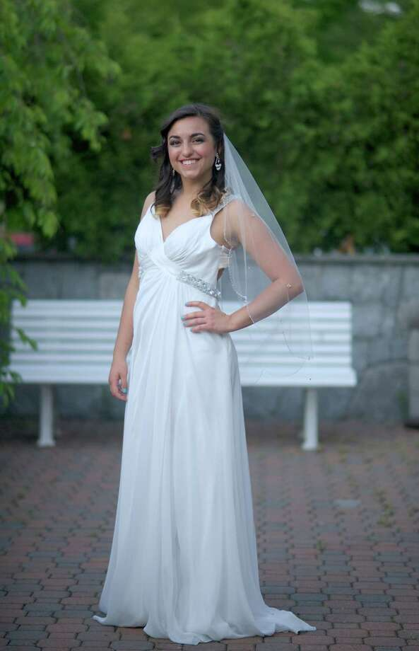 Beatrice Sorena, 18, of Brookfield, Conn., wears a wedding gown exclusively designed by Occasions in Bethel, Conn. Sorena was modeling gowns during the Spring Wedding Expo at the Amber Room Colonnade, in Danbury, Conn. on Monday, June 3, 2013. Photo: H John Voorhees III