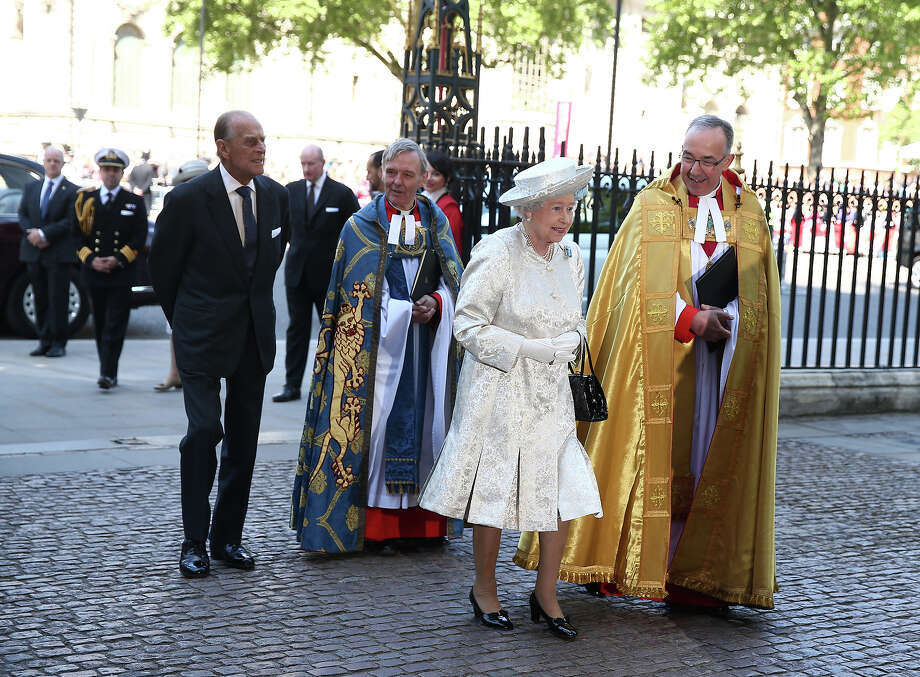 Queen Elizabeth II arrives with Prince Philip, Duke of Edinburgh (L) and Dean of Westminster, The Very Reverend Dr John Hall (R) for a celebration to mark the 60th anniversary of the Coronation Queen Elizabeth II at Westminster Abbey on June 4, 2013 in London, England.  The Queen's Coronation took place on June 2, 1953 after a period of mourning for her father King George VI, following her ascension to the throne on February 6, 1952. The event 60 years ago was the first time a coronation was televised for the public. Photo: Dan Kitwood, Getty Images / 2013 Getty Images