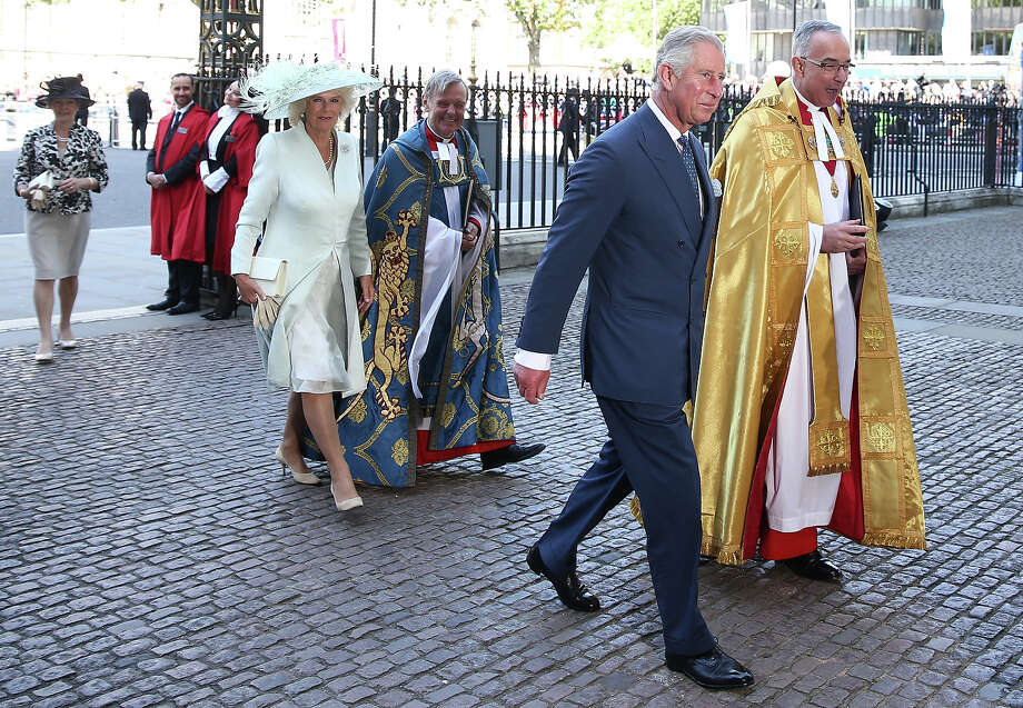 Camilla, Duchess of Cornwall, Prince Charles, Prince of Wales and Dean of Westminster, The Very Reverend Dr John Hall (R) arrive for a celebration to mark the 60th anniversary of the Coronation Queen Elizabeth II at Westminster Abbey on June 4, 2013 in London, England.  The Queen's Coronation took place on June 2, 1953 after a period of mourning for her father King George VI, following her ascension to the throne on February 6, 1952. The event 60 years ago was the first time a coronation was televised for the public. Photo: Dan Kitwood, Getty Images / 2013 Getty Images