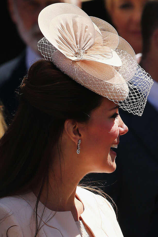 Catherine, Duchess of Cambridge leaves a service of celebration to mark the 60th anniversary of the Coronation Queen Elizabeth II at Westminster Abbey on June 4, 2013 in London, England. The Queen's Coronation took place on June 2, 1953 after a period of mourning for her father King George VI, following her ascension to the throne on February 6, 1952. The event 60 years ago was the first time a coronation was televised for the public. Photo: Dan Kitwood, Getty Images / 2013 Getty Images