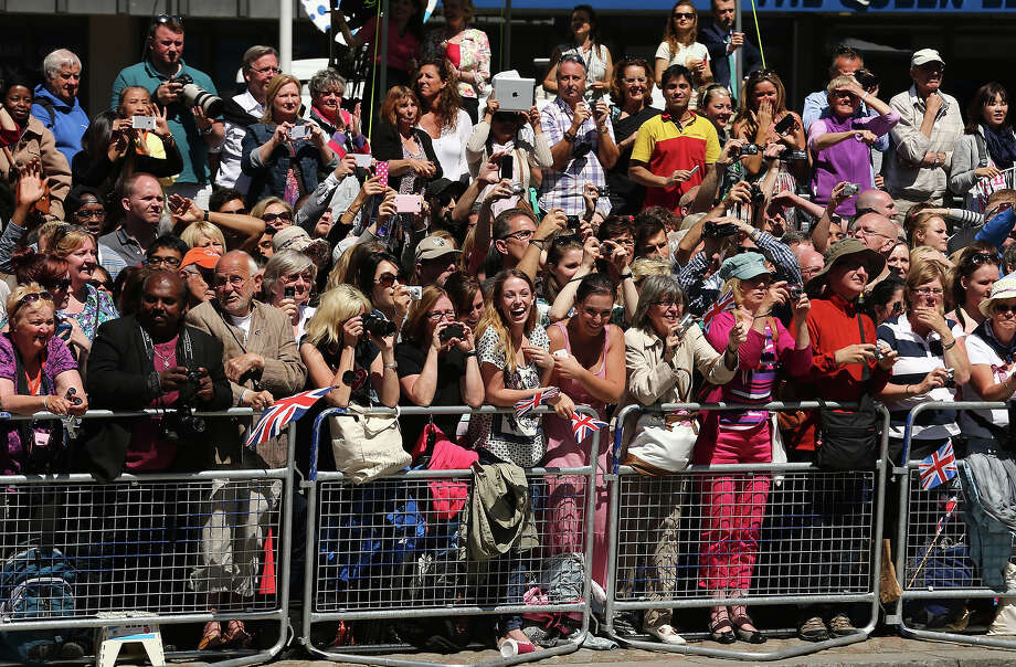 Crowds stand outside a service of celebration to mark the 60th anniversary of the Coronation Queen Elizabeth II at Westminster Abbey on June 4, 2013 in London, England.  The Queen's Coronation took place on June 2, 1953 after a period of mourning for her father King George VI, following her ascension to the throne on February 6, 1952. The event 60 years ago was the first time a coronation was televised for the public. Photo: Dan Kitwood, Getty Images / 2013 Getty Images