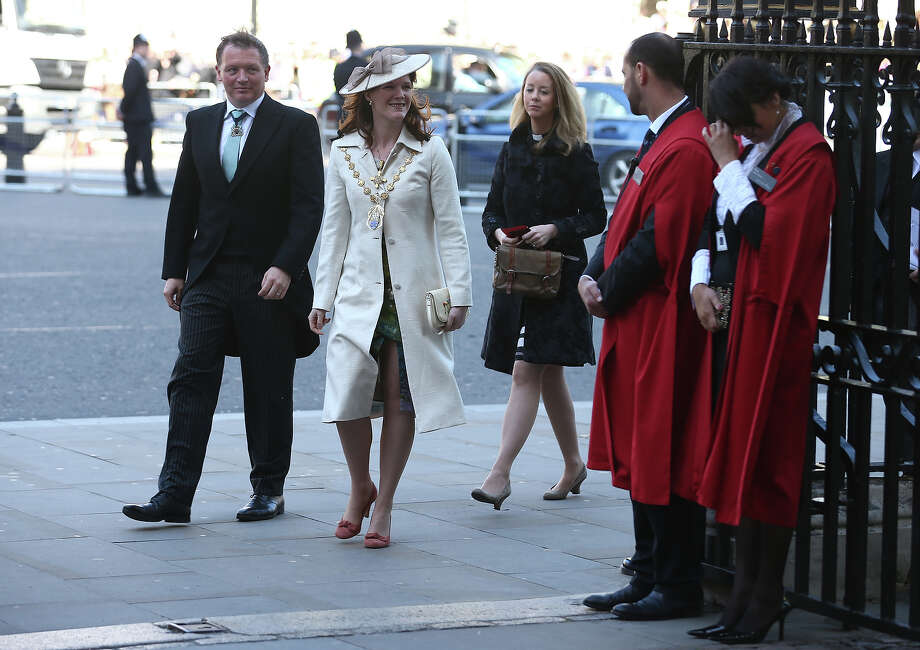 Conservative MP Damian Collins and wife Lord Mayor of Westminster Sarah Richardson (2nd-L) arrive for a service of celebration to mark the 60th anniversary of the Coronation Queen Elizabeth II at Westminster Abbey on June 4, 2013 in London, England.  The Queen's Coronation took place on June 2, 1953 after a period of mourning for her father King George VI, following her ascension to the throne on February 6, 1952. The event 60 years ago was the first time a coronation was televised for the public. Photo: Dan Kitwood, Getty Images / 2013 Getty Images