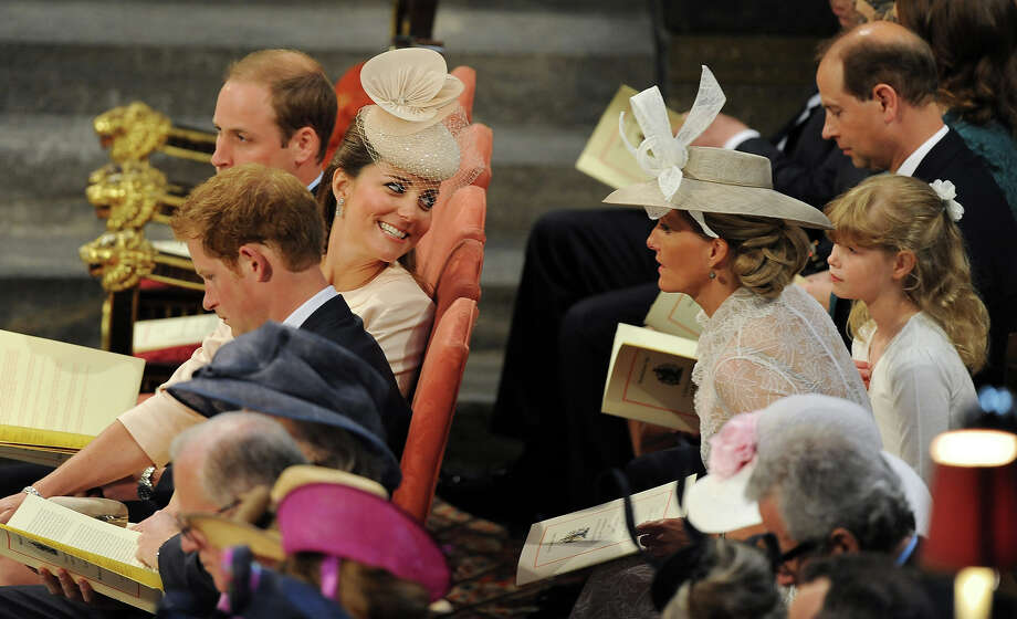 Catherine, Duchess of Cambridge speaks to the Countess of Wessex during the service to celebrate the 60th anniversary of the Coronation of Queen Elizabeth II at Westminster Abbey, on June 4, 2013 in London, England. Photo: WPA Pool, Getty Images / 2013 Getty Images