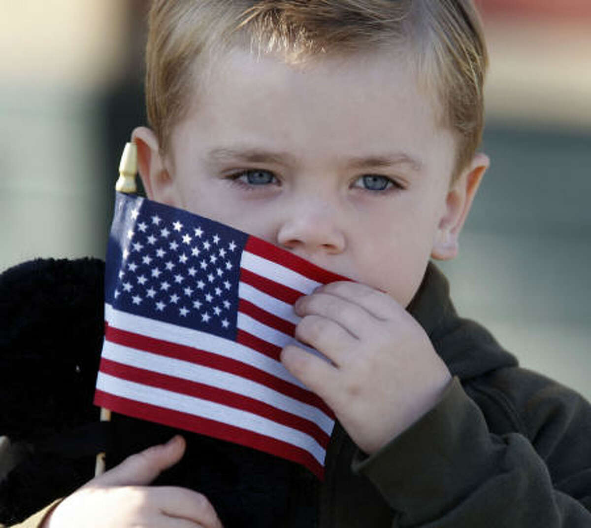 Christopher Johnson, 3, waits for the funeral procession for Army Staff Sgt. Justin DeCrow in Plymouth, Ind., on Nov. 14.