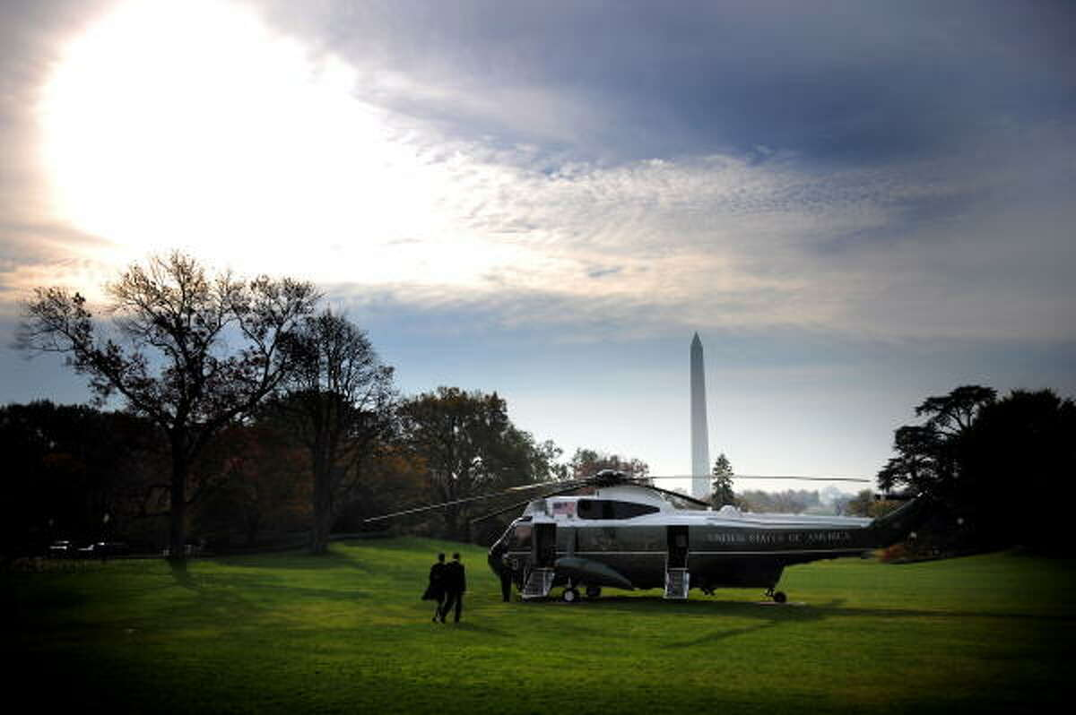 President Barack Obama and First Lady Michelle Obama prepare to board Marine One on the South Lawn of the White House.