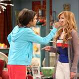 """SHAKE IT UP - """"Home Alone It Up"""" - CeCe convinces her mom to leave her home alone for one night to watch Flynn, but a last minute shoe sale pops up so she enlists Rocky to watch Flynn. When Rocky falls asleep on the job and Flynn disappears, the girls are left to find Flynn before CeCe's mom gets home, in a new episode of """"Shake It Up,"""" SUNDAY, DECEMBER 9 (8:30 PM - 9:00 PM ET/PT) on Disney Channel. (DISNEY CHANNEL/ADAM TAYLOR) ZENDAYA, BELLA THORNE"""