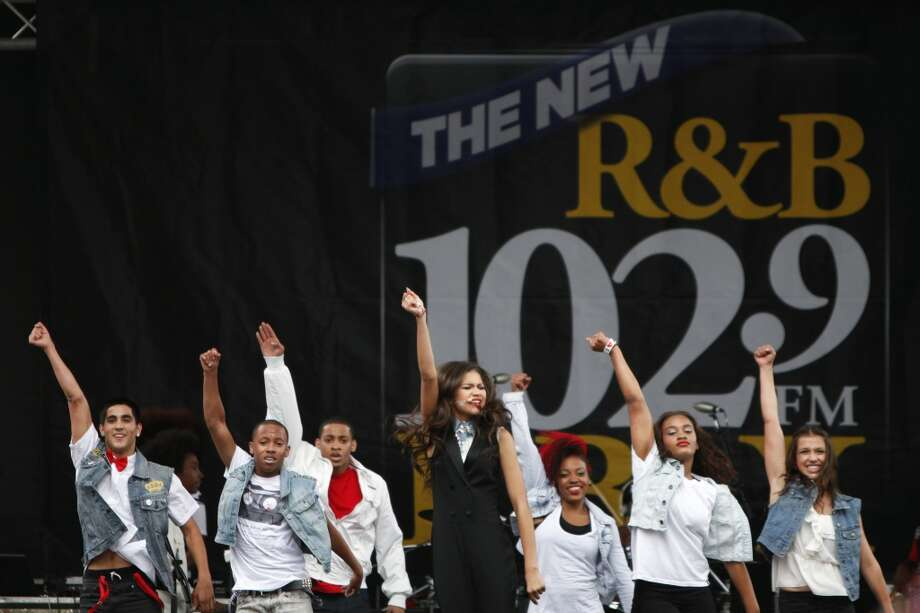 Disney Channel star Zendaya, center, performs at the Art & Soul Oakland festival on Sunday, Aug. 5, 2012, in Oakland, Calif. (Photo by Alison Yin/Invision/AP)