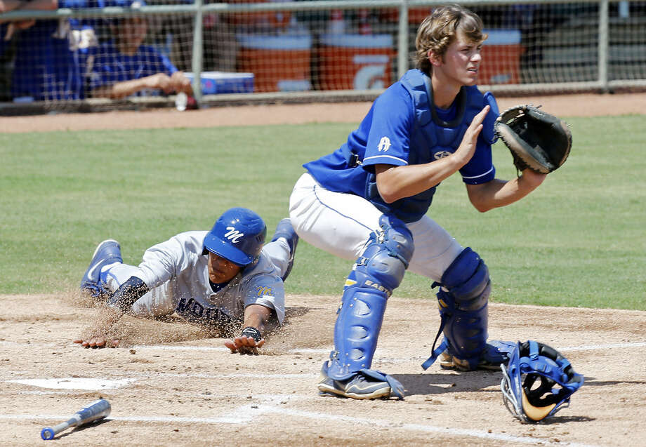 Corpus Christi Moody's Chris Estrada slides home safely past Alamo Heights' Blake Klumpp in a Region IV-4A finals series game Saturday at Wolff Stadium. Photo: Edward A. Ornelas / S.A. Express-News