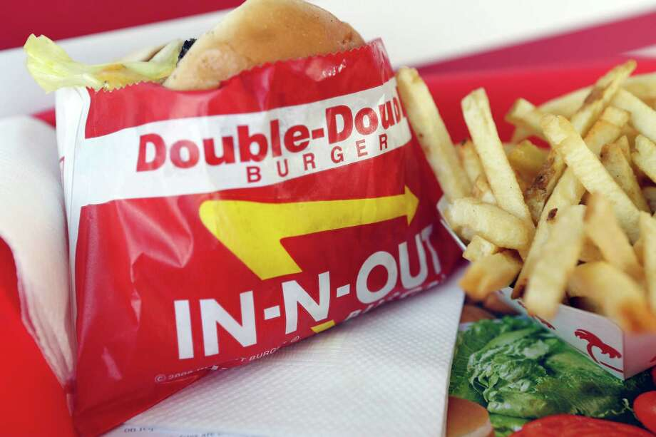 A Double-Double burger and french fries at an In-N-Out Burger restaurant in Costa Mesa, California Photo: Patrick T. Fallon, Bloomberg / © 2013 Bloomberg Finance LP