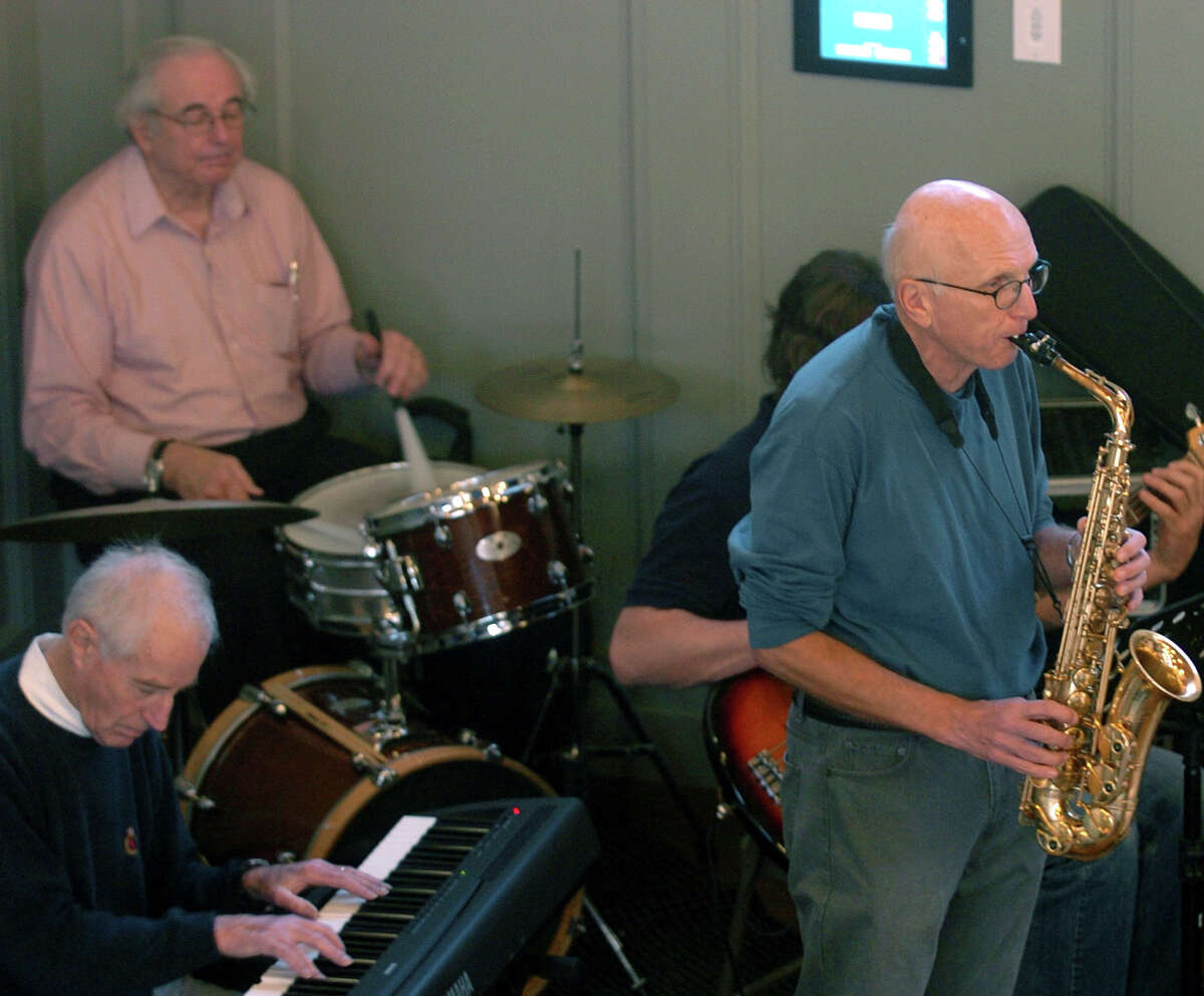Bob Lasprogato, on drums, with his Uptown Jazz group, performing at the annual community Thanksgiving feast sponsored by Saugatuck Congregational Church in November 2011.