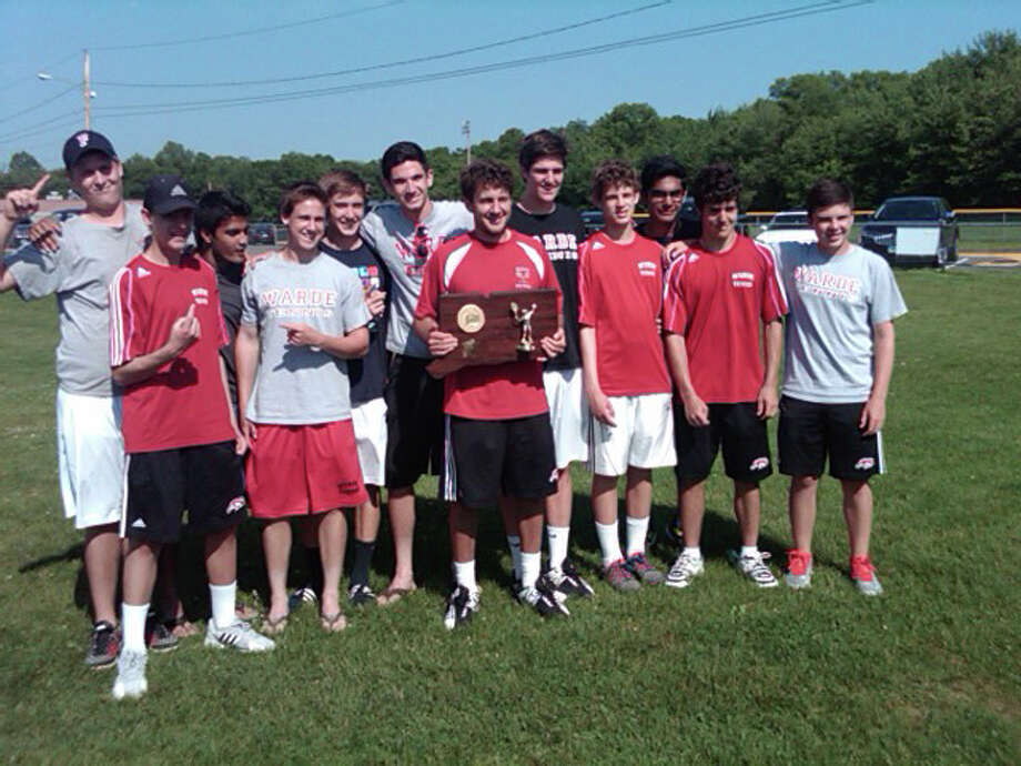 Fairfield Warde's co-state champion boys tennis team, pictured from left: Eric Segerberg, Henry Johnson, Eyad Nagor, Jack Mappa, Danny Pavoni, Devin Pulton, Coach Ben Zuckerberg, Conor McGuinness, Jack Johnson, Kanav Kumar, Ted Berkowitz, Kevin Mercado. Photo: Contributed Photo