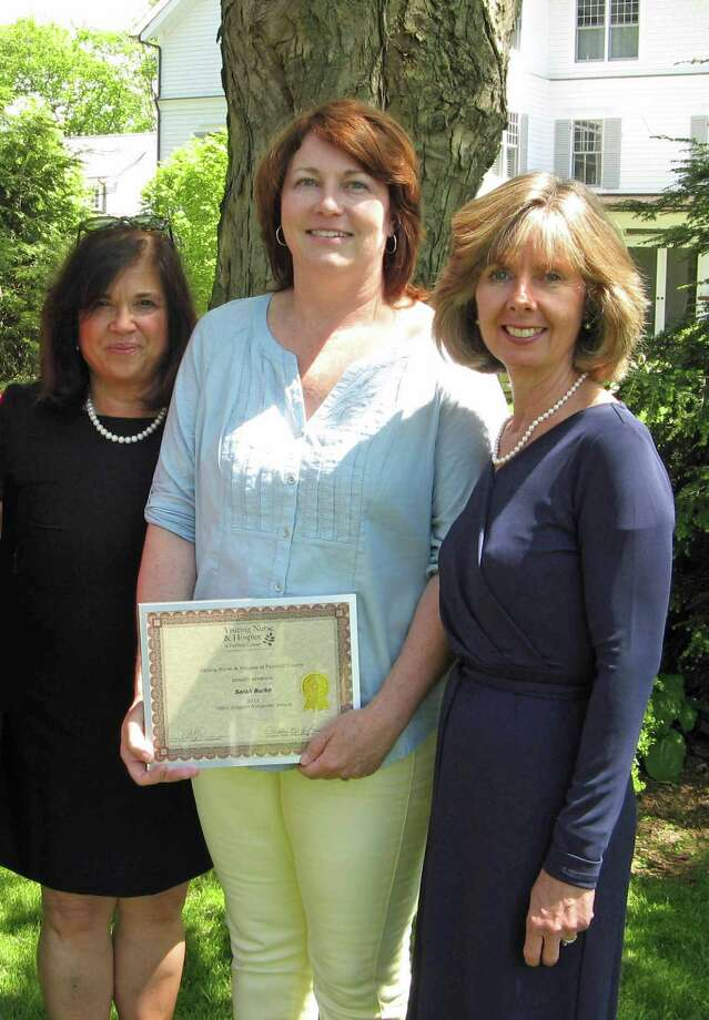 Sarah Burke, center, of New Canaan received a volunteer award for her work as an office support volunteer from Visiting Nurse & Hospice of Fairfield County. She is pictured with Christine Pfeffer, hospice director, and Sharon Bradley, agency president and CEO. Photo: Contributed Photo