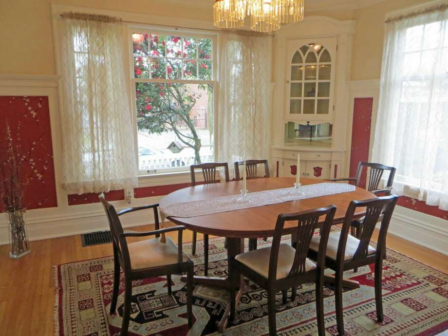 Dining room of 1505 N. 43rd St. The 2,800-square-foot Dutch Colonial-style house, built in 1916, has three bedrooms, including a master bedroom with a fireplace and balcony, full and three-quarter bathrooms, a sun porch, French doors, built-ins and views of downtown Seattle on a 4,000-square-foot lot. It's listed for $815,000. Photo:     Jenifer Horan, Coldwell Banker Bain