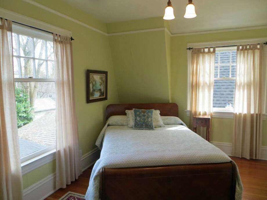 Bedroom of 1505 N. 43rd St. The 2,800-square-foot Dutch Colonial-style house, built in 1916, has three bedrooms, including a master bedroom with a fireplace and balcony, full and three-quarter bathrooms, a sun porch, French doors, built-ins and views of downtown Seattle on a 4,000-square-foot lot. It's listed for $815,000. Photo:     Jenifer Horan, Coldwell Banker Bain