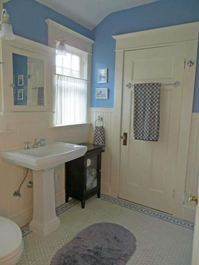 Bathroom of 1505 N. 43rd St. The 2,800-square-foot Dutch Colonial-style house, built in 1916, has three bedrooms, including a master bedroom with a fireplace and balcony, full and three-quarter bathrooms, a sun porch, French doors, built-ins and views of downtown Seattle on a 4,000-square-foot lot. It's listed for $815,000. Photo:     Jenifer Horan, Coldwell Banker Bain