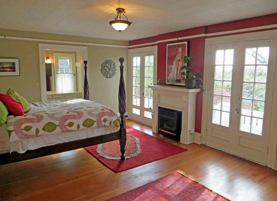 Master bedroom of 1505 N. 43rd St. The 2,800-square-foot Dutch Colonial-style house, built in 1916, has three bedrooms, full and three-quarter bathrooms, a sun porch, French doors, built-ins and views of downtown Seattle on a 4,000-square-foot lot. It's listed for $815,000. Photo:     Jenifer Horan, Coldwell Banker Bain