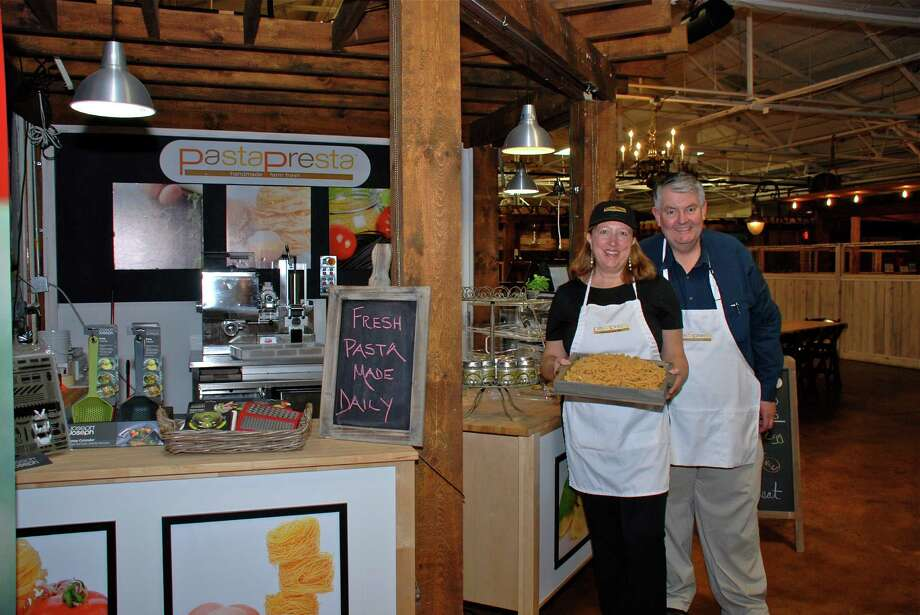 Meri and Bill Erickson of New Canaan present a tray of fresh pasta at their new specialty shop, PastaPresta, at the SoNo Marketplace on May 9, 2013, in South Norwalk, Conn. Photo: Jeanna Petersen Shepard / New Canaan News Freelance
