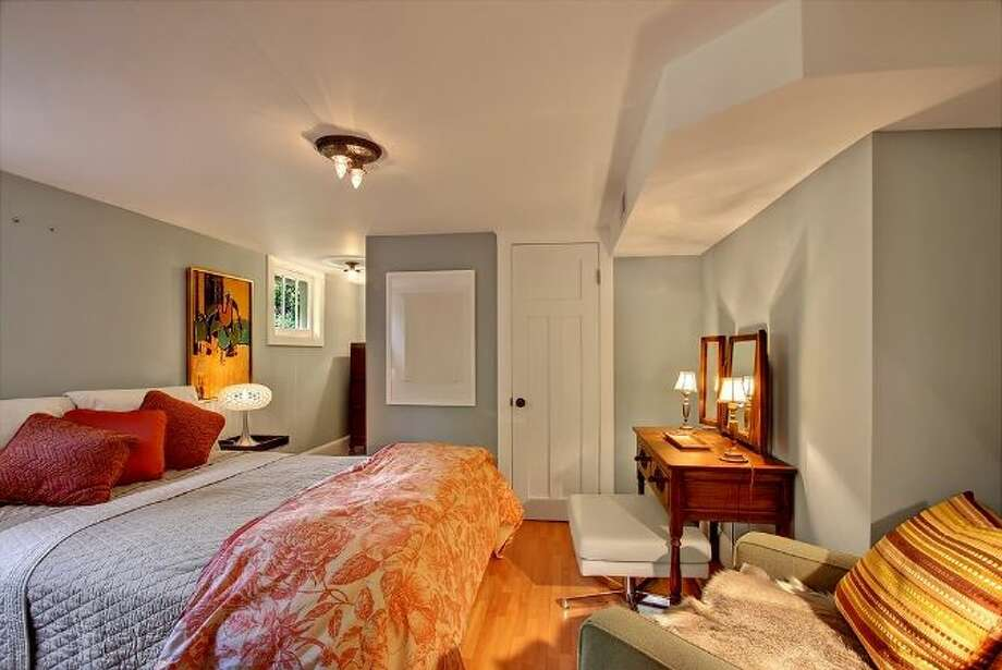 Basement apartment bedroom of 5622 Keystone Place N. The 2,230-square-foot Craftsman, built in 1920, has four bedrooms and 2.25 bathrooms, built-ins, French doors, wainscoting, a front porch and a back deck on a 5,625-square-foot lot. It's listed for $837,000. Photo: Courtesy Peter Richmond, Windermere Real Estate