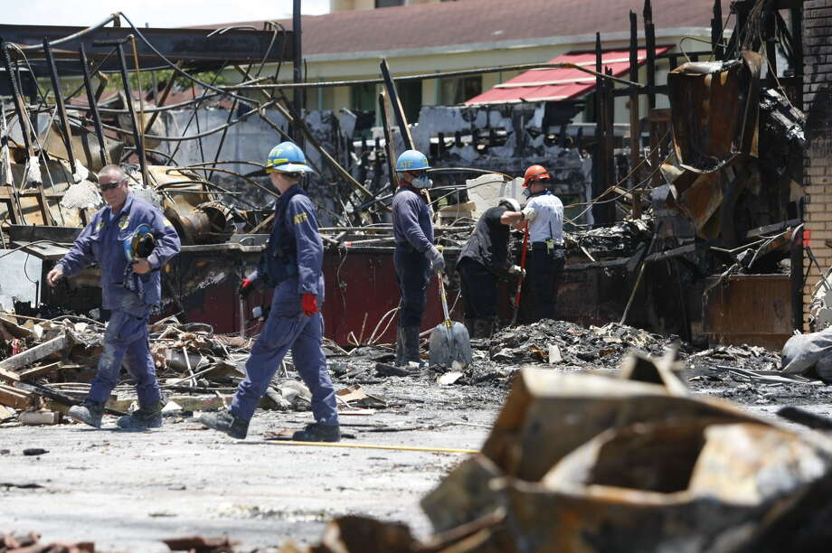 ATF goes through the rubble Tuesday. Photo: Johnny Hanson/Chronicle