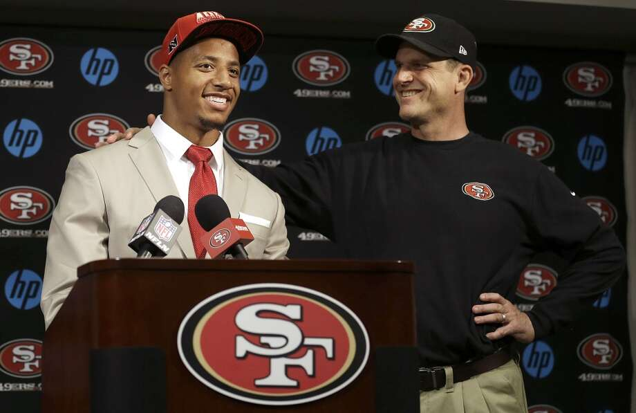 Safety Eric Reid, the first-round draft pick of the San Francisco 49ers, left, smiles as stands next to head coach Jim Harbaugh during a news conference at the team's training facility in Santa Clara, Calif., Friday, April 26, 2013. Photo: Jeff Chiu, Associated Press