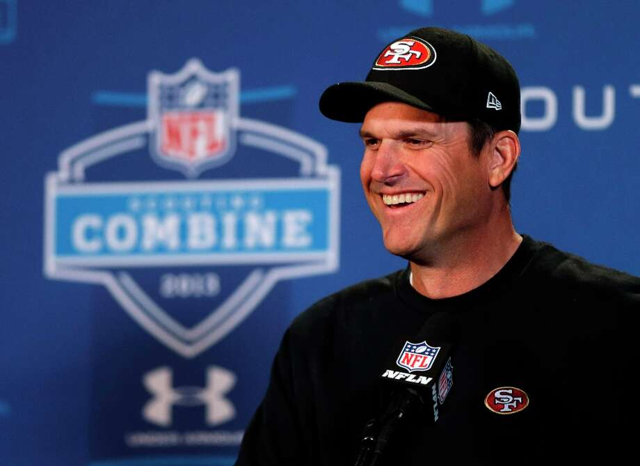 San Francisco 49ers head coach Jim Harbaugh answers a question during a news conference at the NFL football scouting combine in Indianapolis, Friday, Feb. 22, 2013. Photo: Michael Conroy, Associated Press / AP