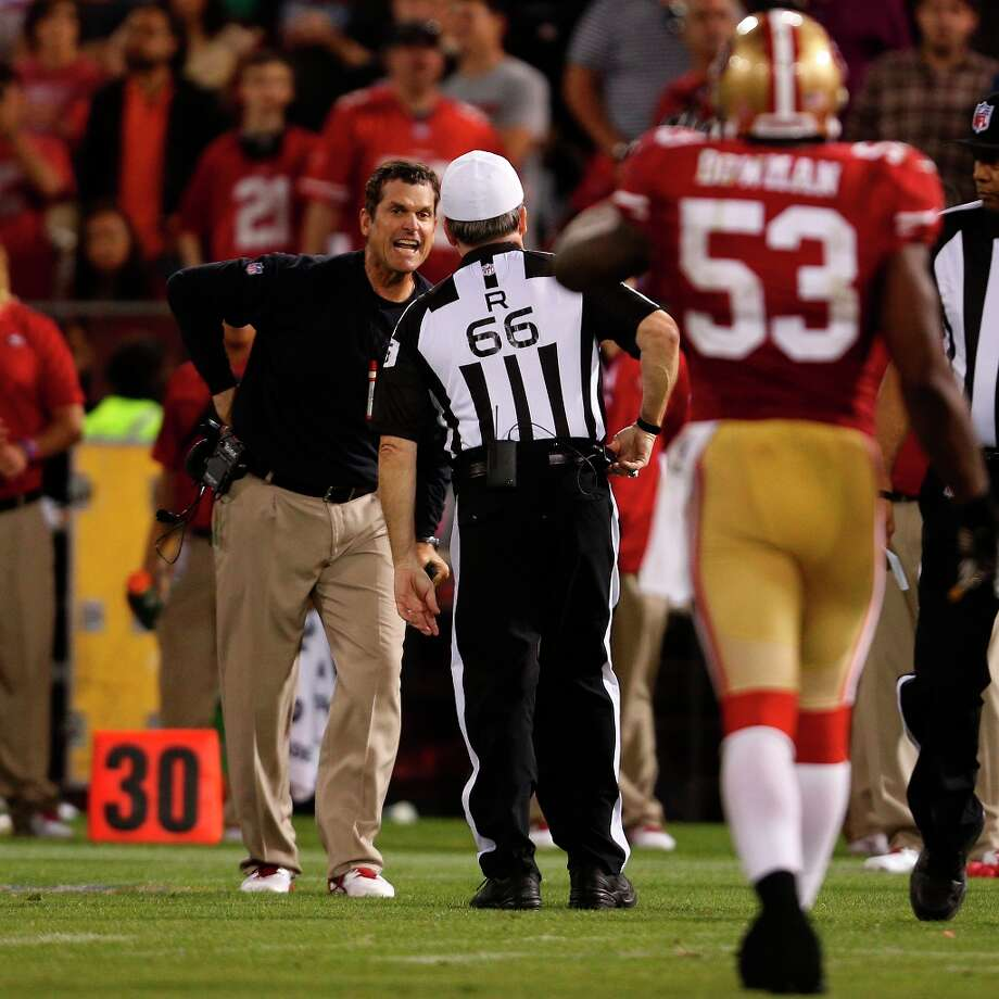 San Francisco 49ers Head Coach Jim Harbaugh argues a call with referee Walt Anderson during the fourth quarter against the visiting Seattle Seahawks at Candlestick Park in San Francisco, Calif. on Thursday, October 18, 2012. The 49ers defeated the Seahawks 13-6. Photo: John Storey, Special To The Chronicle / ONLINE_YES