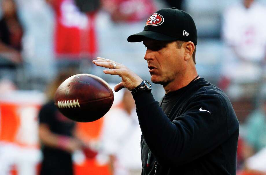 San Francisco 49ers head coach Jim Harbaugh tosses a football prior to an NFL football game against the Arizona Cardinals Monday, Oct. 29, 2012, in Glendale, Ariz.  The 49ers defeated the Cardinals 24-3. Photo: Ross D. Franklin, Associated Press / AP