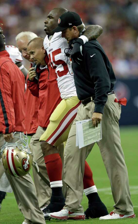 San Francisco 49ers running back Brandon Jacobs (45) is helped off the field by head coach Jim Harbaugh, right, in the first quarter an NFL preseason football game Saturday, Aug. 18, 2012, in Houston. Photo: David J. Phillip, Associated Press / AP