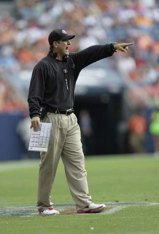 San Francisco 49ers head coach Jim Harbaugh yells during the second half of an NFL preseason football game against the Denver Broncos in Denver, Sunday, Aug. 26, 2012. Photo: Joe Mahoney, Associated Press / FR170458 AP
