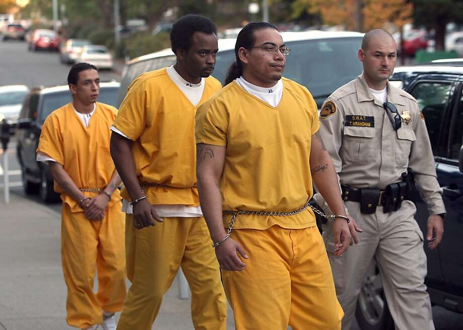From right, Elvis Torrentes, 21, John Crane Jr., 43, and Jose Montano, suspects in the Richmond High School gang rape, attend a preliminary hearing in Martinez on Monday. Photo: Liz Hafalia, The Chronicle
